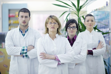 medical students: team of  pharmacist chemist woman and man  group  standing in pharmacy drugstore Stock Photo