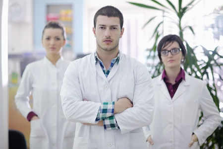 lab coat: team of  pharmacist chemist woman and man  group  standing in pharmacy drugstore Stock Photo
