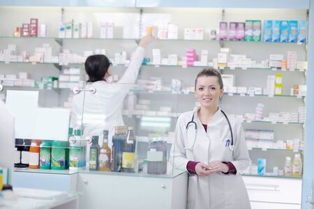 sales assistant: team of  pharmacist chemist woman group  standing in pharmacy drugstore