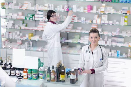 team of  pharmacist chemist woman group  standing in pharmacy drugstore Stock Photo - 13660143