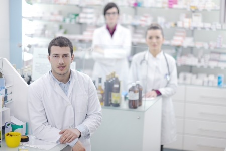 team of  pharmacist chemist woman and man  group  standing in pharmacy drugstore Stock Photo - 13661921