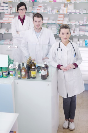 healthcare team: team of  pharmacist chemist woman and man  group  standing in pharmacy drugstore Stock Photo