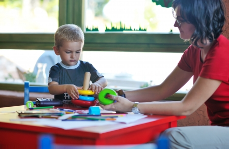 kinder garden: happy little child play game and have fun, education lessons in colorful kinder garden playground indoors Stock Photo