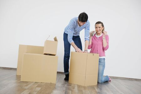 happy Young couple moving in new house Stock Photo - 13710574