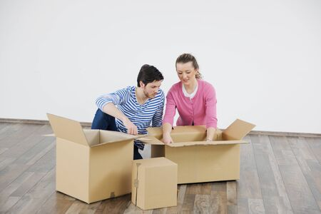happy Young couple moving in new house Stock Photo - 13710616