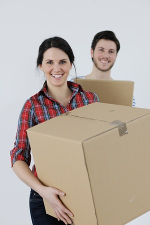 happy Young couple moving in new house Stock Photo - 13710635
