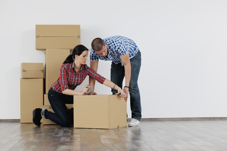 happy Young couple moving in new house Stock Photo - 13710754