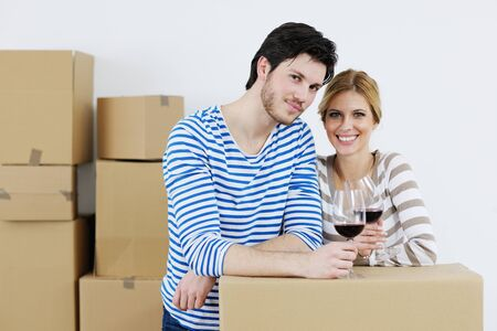 happy Young couple moving in new house Stock Photo - 13710784