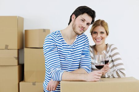 happy Young couple moving in new house Stock Photo - 13710783