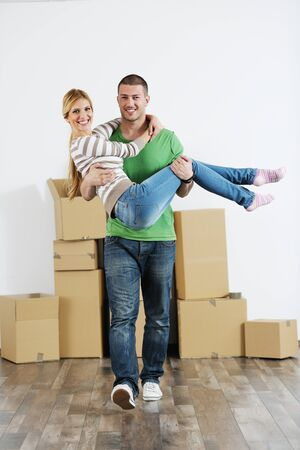 happy Young couple moving in new house Stock Photo - 13710786