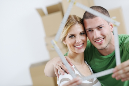house moving: happy Young couple moving in new house
