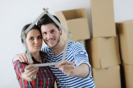 happy Young couple moving in new house Stock Photo - 13710753