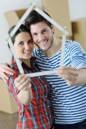 property investment: happy Young couple moving in new house