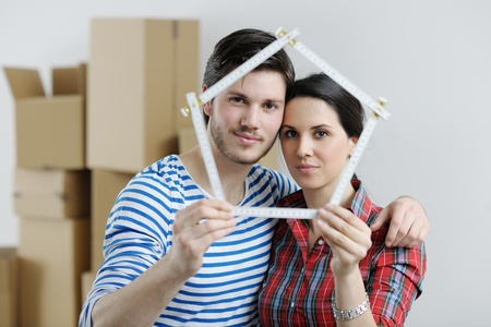 happy Young couple moving in new house Stock Photo - 13710782