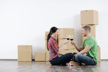 real estate people: happy Young couple moving in new house