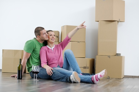 happy Young couple moving in new house Stock Photo - 13710568
