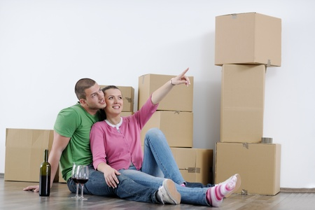 happy Young couple moving in new house Stock Photo - 13710561