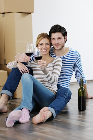 happy Young couple moving in new house Stock Photo - 13710785