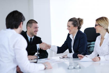 Group of happy young  business people in a meeting at office Stock Photo - 13753148