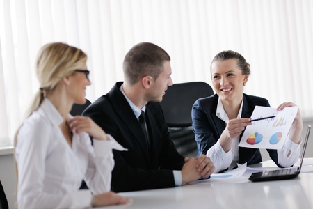 Group of happy young  business people in a meeting at office Stock Photo - 13774389