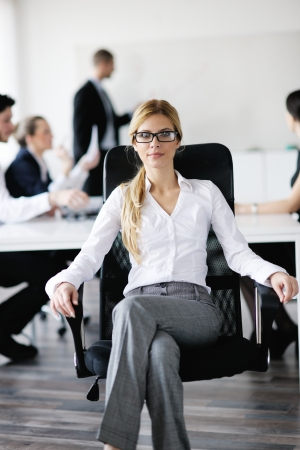 business woman  with her staff,  people group in background at modern bright office indoors Stock Photo - 13753156