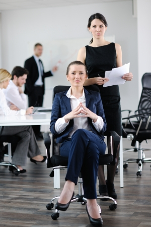 business woman  with her staff,  people group in background at modern bright office indoors Stock Photo - 13774441