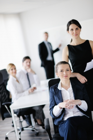 business woman  with her staff,  people group in background at modern bright office indoors Stock Photo - 17621568