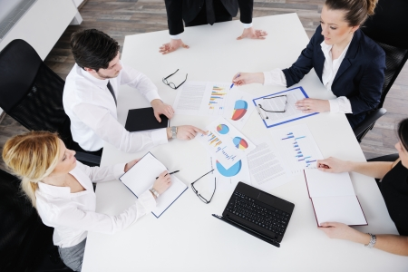 Group of happy young  business people in a meeting at office Stock Photo - 17732756