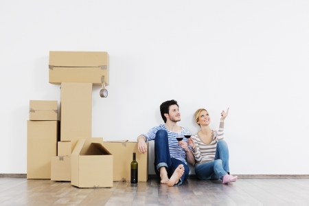 happy Young couple moving in new house Stock Photo - 13774442