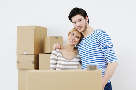 happy Young couple moving in new house Stock Photo - 13774538