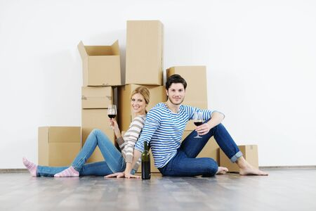 happy Young couple moving in new house Stock Photo - 13774487