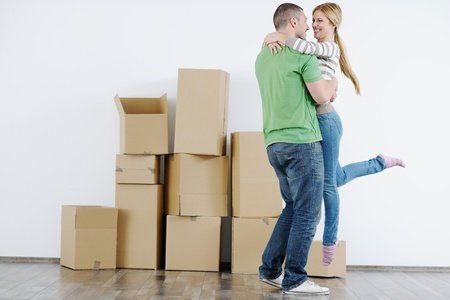 happy Young couple moving in new house Stock Photo - 13774516