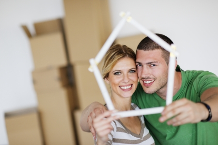 buyers: happy Young couple moving in new house