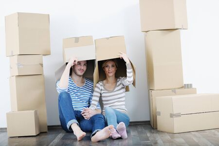 happy Young couple moving in new house photo