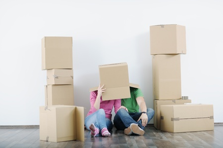 happy Young couple moving in new house Stock Photo - 13733983