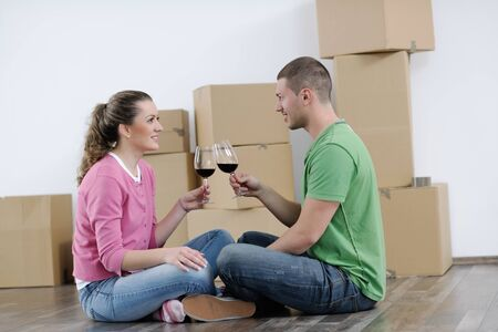 happy Young couple moving in new house Stock Photo - 13753611