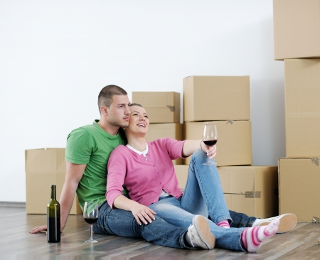 happy Young couple moving in new house Stock Photo - 13753602