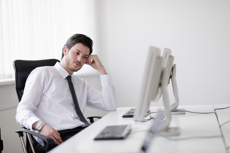 Portrait of a young business man looking depressed and worried from work at meeting office indors Stock Photo - 13774642