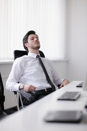 Portrait of a young business man looking depressed and worried from work at meeting office indors photo