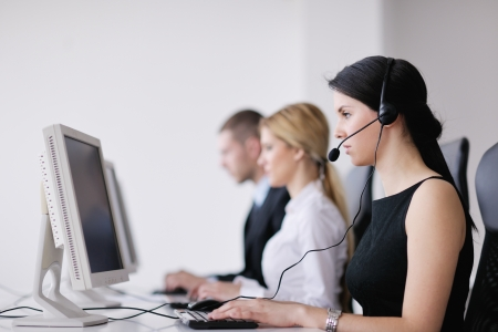 business people group with  headphones giving support in  help desk office to customers, manager giving training and education instructions Stock Photo - 13775279