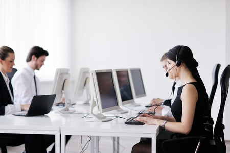 business people group with  headphones giving support in  help desk office to customers, manager giving training and education instructions Stock Photo - 13774866