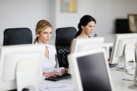 sales team: business people group with  headphones giving support in  help desk office to customers, manager giving training and education instructions Stock Photo
