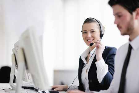 telephone call: business people group with  headphones giving support in  help desk office to customers, manager giving training and education instructions Stock Photo
