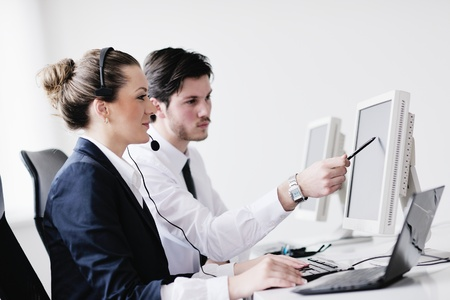business people group with  headphones giving support in  help desk office to customers, manager giving training and education instructions Stock Photo - 13774600