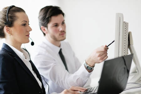 business people group with  headphones giving support in  help desk office to customers, manager giving training and education instructions Stock Photo - 13774605