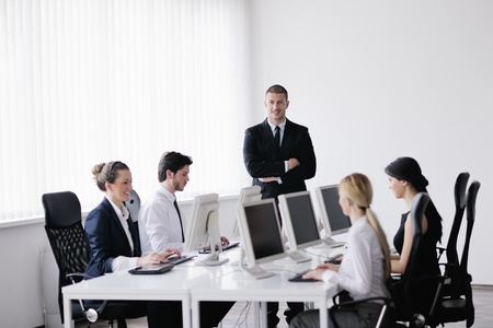 business people group with  headphones giving support in  help desk office to customers, manager giving training and education instructions Stock Photo - 13774638