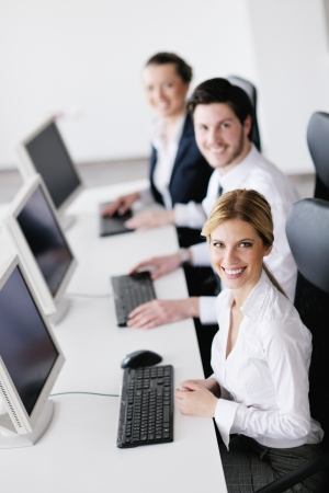 business people group with  headphones giving support in  help desk office to customers, manager giving training and education instructions Stock Photo - 13774921