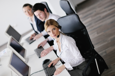 business people group with  headphones giving support in  help desk office to customers, manager giving training and education instructions Stock Photo - 13775294