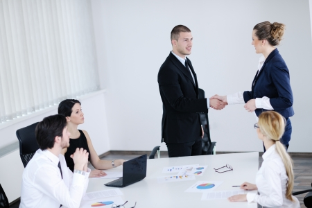 Group of happy young  business people in a meeting at office Stock Photo - 13774969