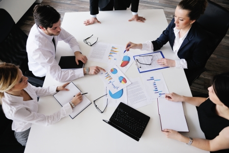 Group of happy young  business people in a meeting at office Stock Photo - 13775248